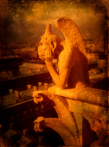 Decoration「Closeup view of a stone figured dragon gargoyle on the Notre Dame Cathedral in Paris, France.  d」:スマホ壁紙(18)