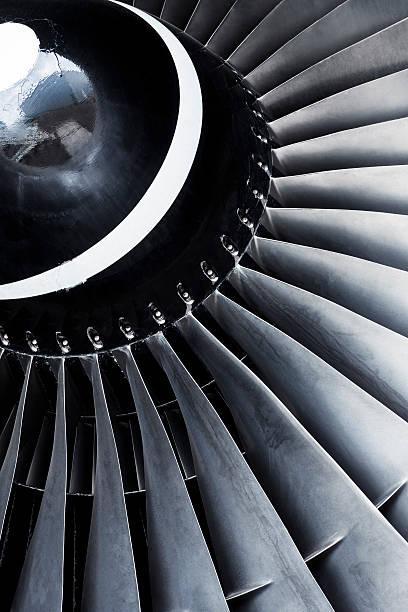A close-up view of an aircraft jet engine turbine:スマホ壁紙(壁紙.com)