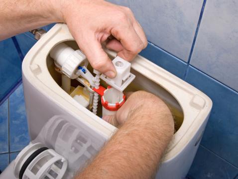 Toilet「Plumber repairing the mechanism of a toilet」:スマホ壁紙(12)
