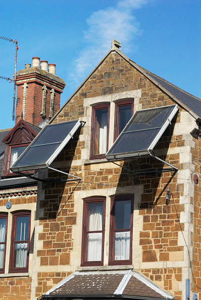 King's Lynn「Solar panels erected on a frame to face southwards from a wall of a house, Kings Lynn, Norfolk, UK」:写真・画像(4)[壁紙.com]