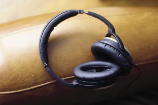 Headphone「Padded headphones on leather chair」:スマホ壁紙(0)