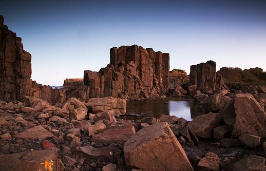 Basalt「Dramatic coastal basalt columns rock formations at sunset at the disused Bombo Quarry site on Bombo Headland south of Sydney near Kiama, NSW, Australia」:スマホ壁紙(16)