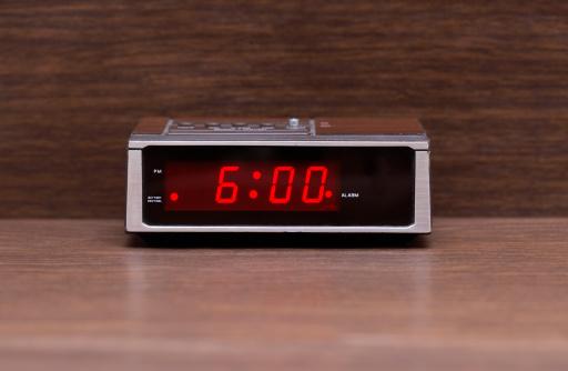 Alarm Clock「Digital alarm clock on wooden surface」:スマホ壁紙(17)