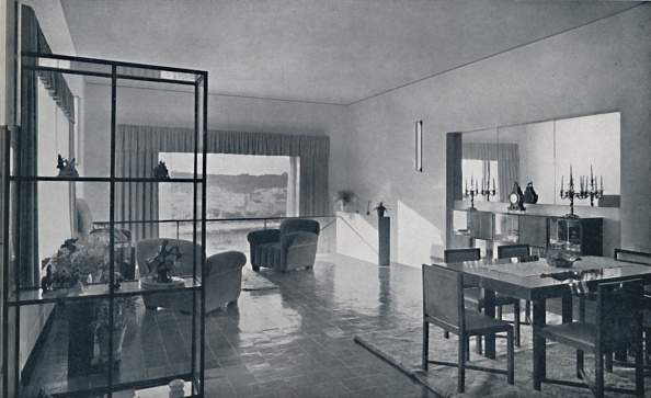 Upholstered Furniture「Paniconi And Pediconi A Dining Room With A Large Window And Curtains Designed To Frame A Beautiful Artist: Unknown」:写真・画像(11)[壁紙.com]