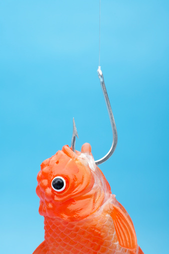 1人「Plastic orange toy fish caught on fishing hook against turquoise background」:スマホ壁紙(1)