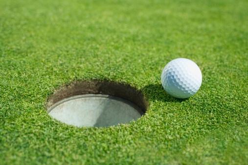 Off Target「Golf ball near cup on putting green outdoors」:スマホ壁紙(8)