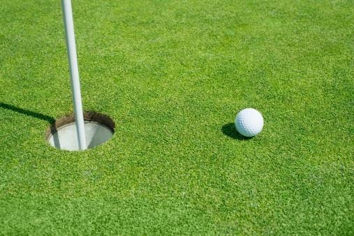 Off Target「Golf ball near cup on putting green outdoors」:スマホ壁紙(16)