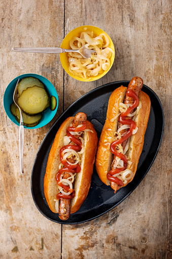 Hot Dog「Artisan hot dogs in a brioche bun with onions and ketchup.」:スマホ壁紙(4)