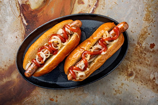 Hot Dog「Artisan hot dogs in a brioche bun with onions and ketchup.」:スマホ壁紙(11)