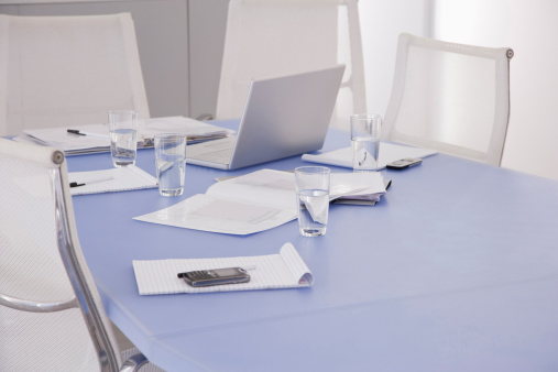Electronics Industry「Laptop and documents on table in conference room」:スマホ壁紙(9)