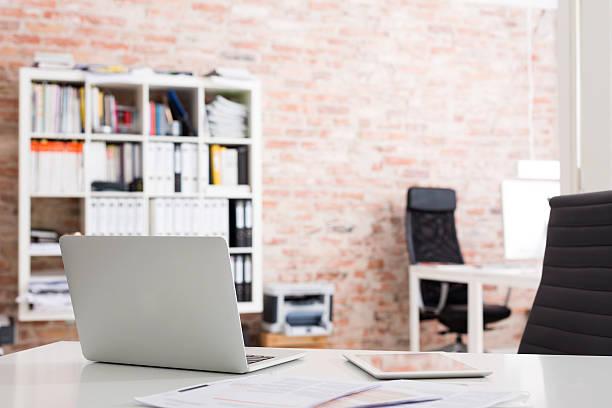 Laptop and digital tablet on desk in office:スマホ壁紙(壁紙.com)