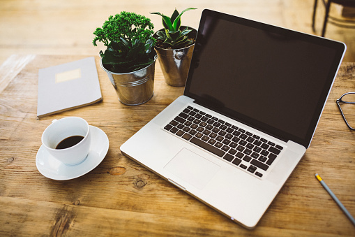Casual Clothing「Laptop and a cup of coffee on a table」:スマホ壁紙(15)