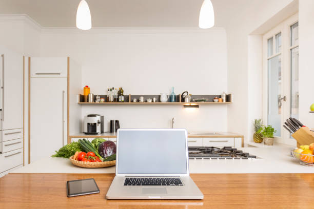 Laptop and tablet on kitchen counter:スマホ壁紙(壁紙.com)