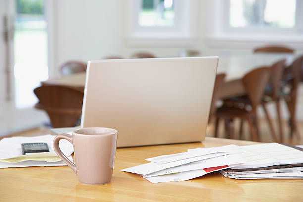 Laptop and paperwork on kitchen counter with mug:スマホ壁紙(壁紙.com)