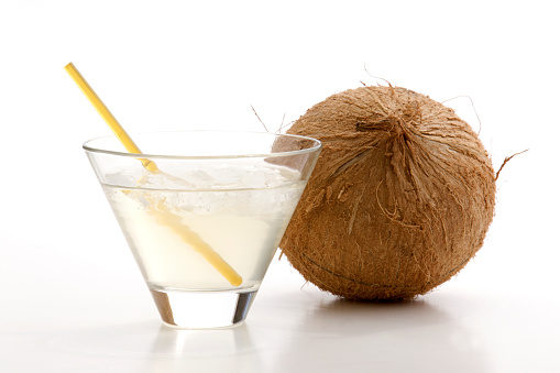 Coconut Water「Glass of coconut water with ice, a straw, and a whole coconut next to it on a white background」:スマホ壁紙(14)