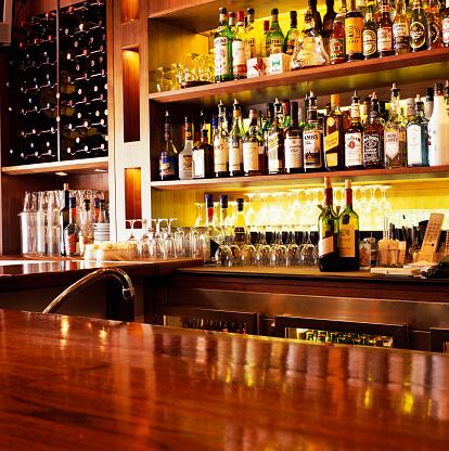 Bottle「Liquor Bottles Sitting on Shelves」:スマホ壁紙(11)