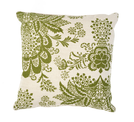 Pillow「Green and white couch pillow with a floral pattern」:スマホ壁紙(1)