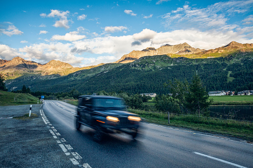 Engadin Valley「Off-Road car driving along asphalt road in Engadin valley」:スマホ壁紙(3)