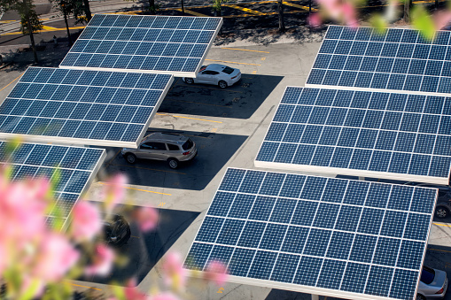 Solar Mirror「close up solar panels placed on a city public parking lot」:スマホ壁紙(8)