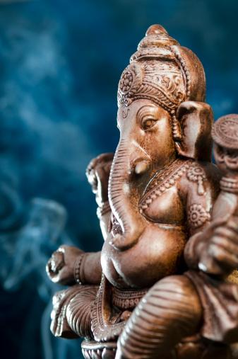 Hinduism「Deity of Ganesha from India on blue background」:スマホ壁紙(13)