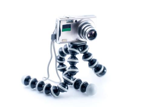 Eyesight「Small metal Digital photo camera and tripod on white background」:スマホ壁紙(1)