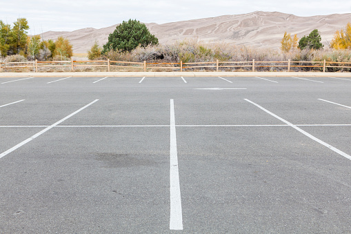 Parking Lot「An empty parking lot in Great Sand Dunes National Park, Colorado during the government shutdown.」:スマホ壁紙(16)