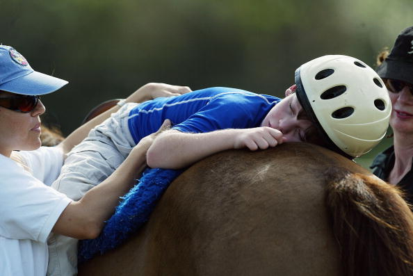 Autism「Austistic Boy with Cerebral Palsy Undergoes Horse Therapy」:写真・画像(5)[壁紙.com]