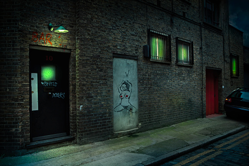 Spooky「Graffiti on alley doors in city at night」:スマホ壁紙(4)