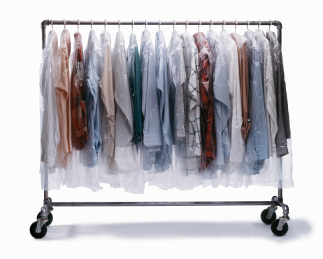 Rack「Dry-cleaned clothes wrapped in plastic hanging on clothes rack」:スマホ壁紙(14)