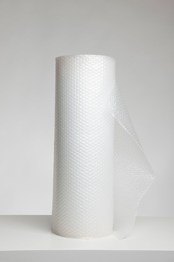Gray Background「Roll of bubble wrap against light grey background」:スマホ壁紙(7)