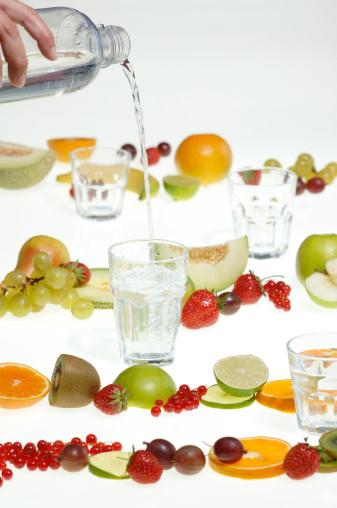 メロン「Hand pouring water into glass; fresh fruits」:スマホ壁紙(0)