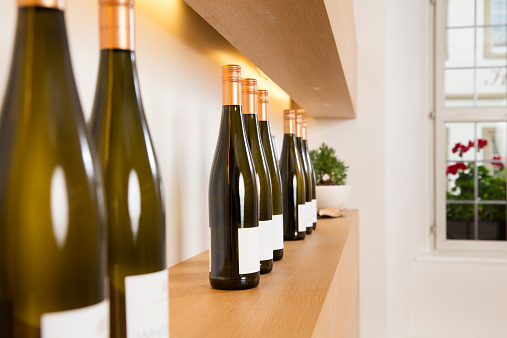Wine Bottle「Bottles of white wine on shelf」:スマホ壁紙(3)