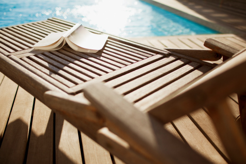 Deck Chair「Open book on lounge chair near swimming pool」:スマホ壁紙(7)