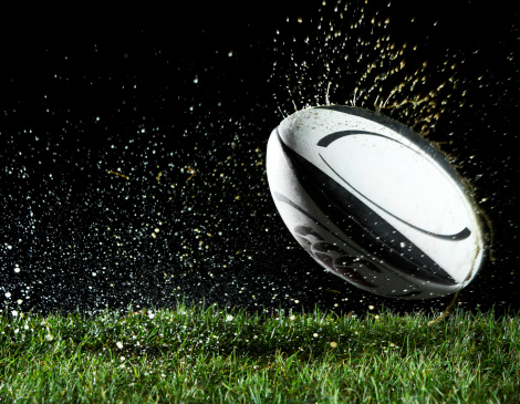 Spraying「Rugby ball in motion over grass」:スマホ壁紙(7)