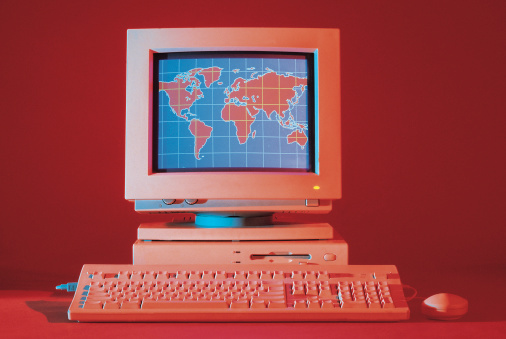 1990-1999「Desktop computer with world map on monitor」:スマホ壁紙(13)