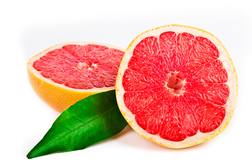 Grapefruit「Pink grapefruit cut in half with a green leaf」:スマホ壁紙(2)