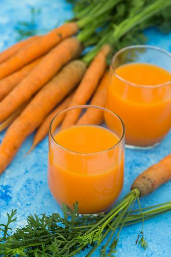Vegetable Juice「Two glasses of fresh carrot juice and  carrots on light blue ground」:スマホ壁紙(9)
