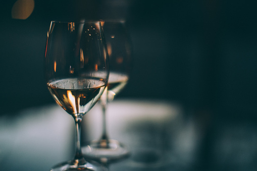 Liquor「Two glasses of white wine on a table」:スマホ壁紙(12)