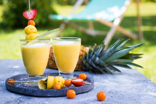 Winter Cherry「Two glasses of tropical smoothie with pineapple, mango, coconut milk and coconut flakes」:スマホ壁紙(9)