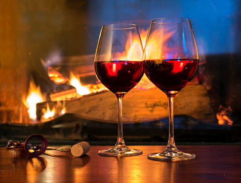 Drinking「Two glasses of red wine in front of a fireplace」:スマホ壁紙(1)