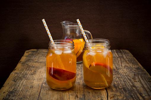 Ice Tea「Two glasses of peach orange ice tea on wood」:スマホ壁紙(8)