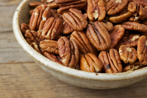 Bowl「Bowl of pecan nuts on old wood table」:スマホ壁紙(0)