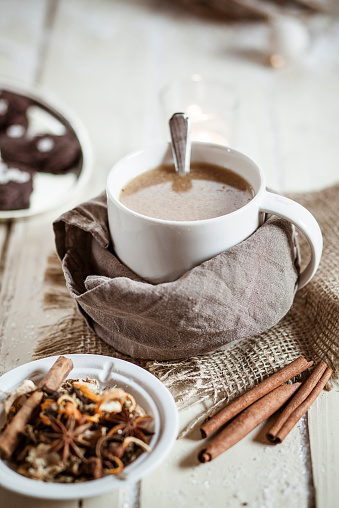 Clove - Spice「Bowl of Masala chai with almond milk on jute and wood」:スマホ壁紙(3)