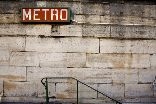 Brick Wall「Brick wall and slope with a red Metro Sign on top」:スマホ壁紙(0)