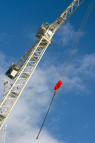 Finance and Economy「Tower cranes with pulley lifting attachment and cables」:写真・画像(1)[壁紙.com]