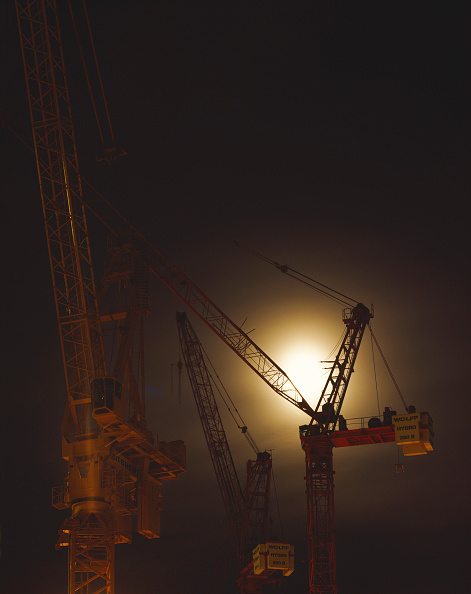 Construction Equipment「Tower cranes silhouetted at night.」:写真・画像(16)[壁紙.com]
