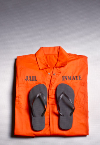 Clothing「Orange jump suit in prison cell」:スマホ壁紙(4)