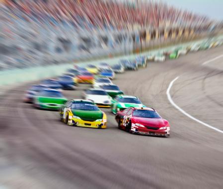 Motorsport「Race cars racing around a track.」:スマホ壁紙(2)