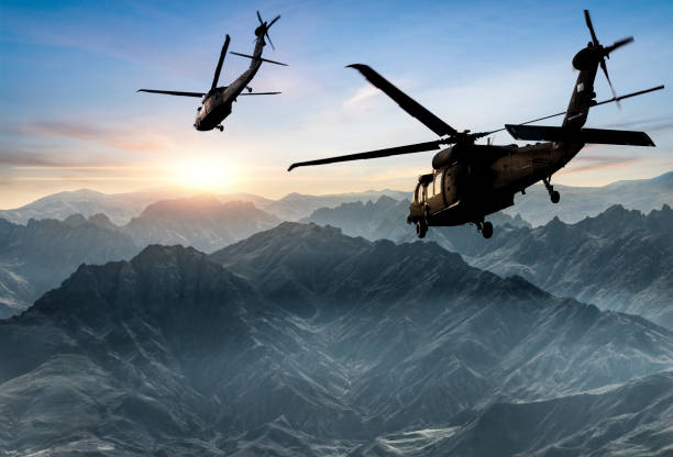 Military Helicopters flying against sunset:スマホ壁紙(壁紙.com)