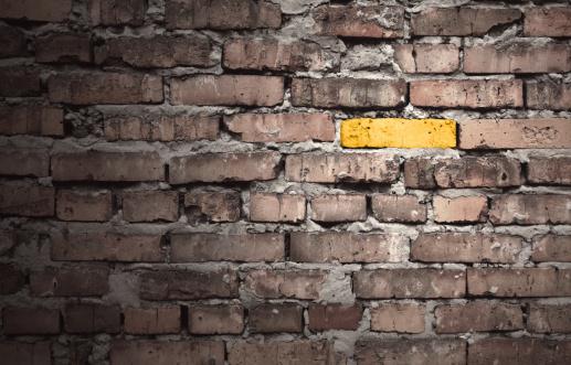 Brick Wall「Brown brick wall with one gold brick」:スマホ壁紙(14)